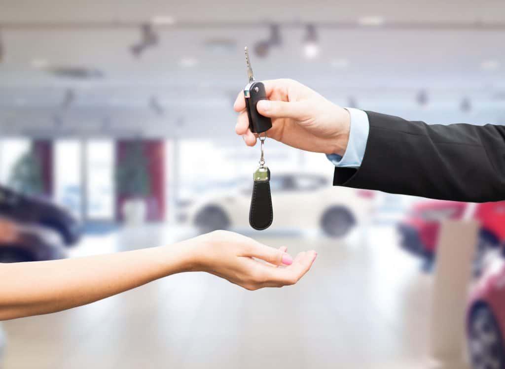 customer with salesman and car key