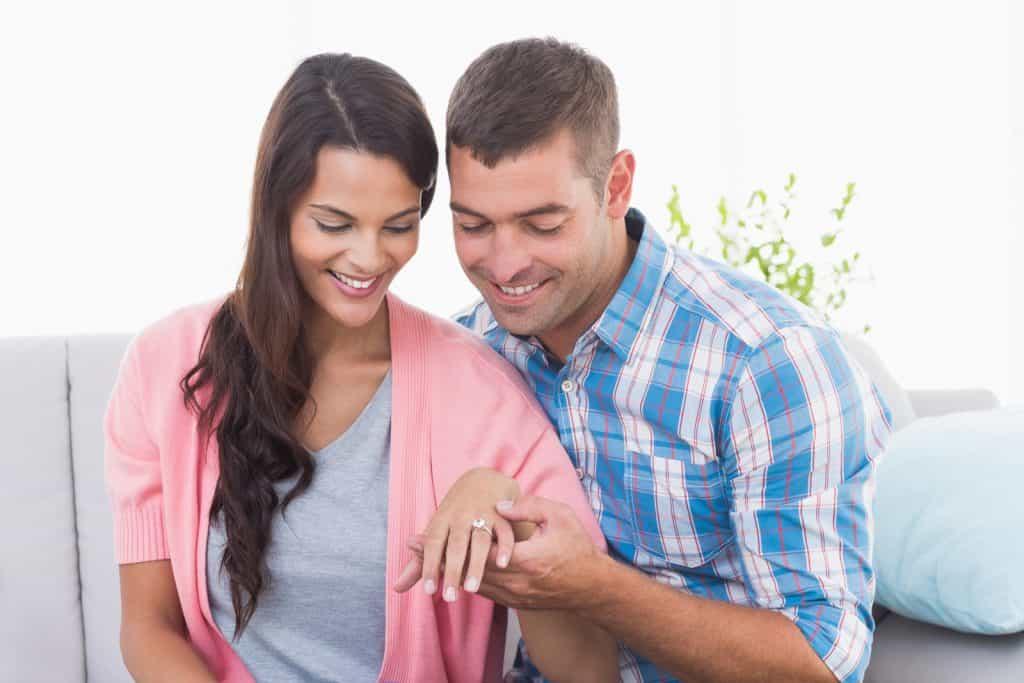 man and woman looking at ring