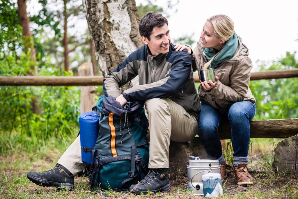 Man and woman taking break from hiking