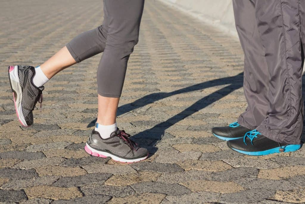 couple in running shoes